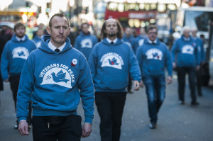 Ex-servicemen mark remembrance day by marching in defiance of war