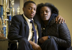 Darren Manning, pictured with his mum. A police woman frisk-searched him so violently that she ruptured his testicles.