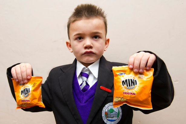 School excludes six year old for eating mini cheddars at lunch