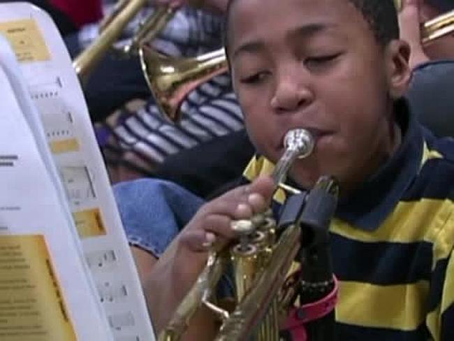 Armless child becomes role model for others after beating all odds and playing trumpet