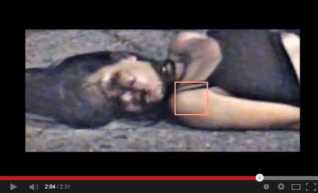 The screenshot of the video-taped incident shoes a handcuffed, half-naked Nguyen with one of the straps on her top missing