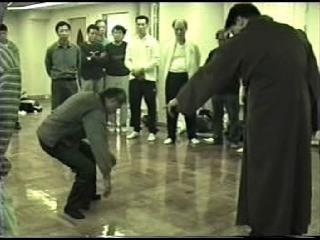 This picture shows a demonstration of spontaneous qigong as seen in the video