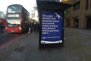 Anti-police brutality posters have appeared at bus stops