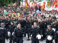 German police took off their helmets and marched in solidarity with anti-austerity protestors