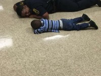 Indiana Cop comforts a kid in the most awesome way