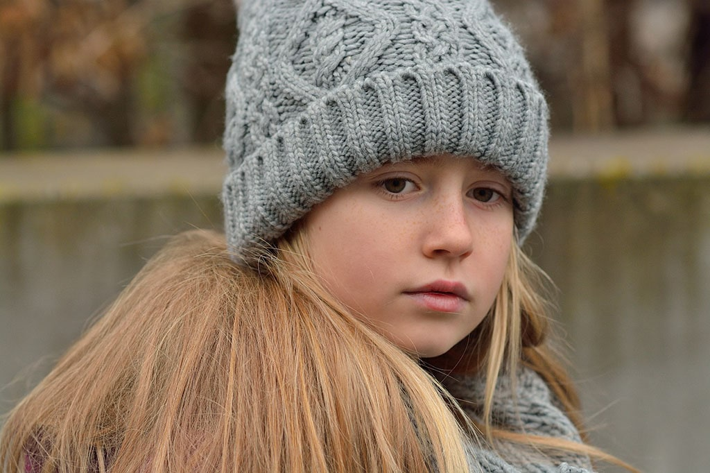 Forlorn young girl looks out into distance