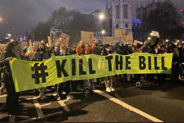 Protesters hold up Kill The Bill yellow banner