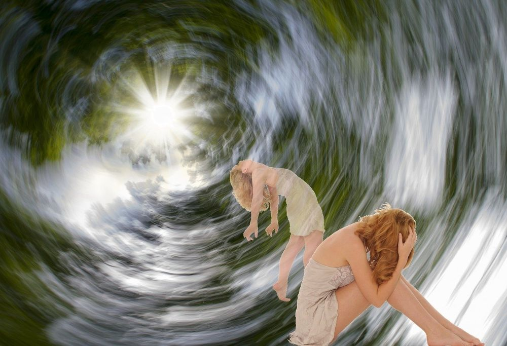 A spirit leaves the body of a woman in a swirling cloud