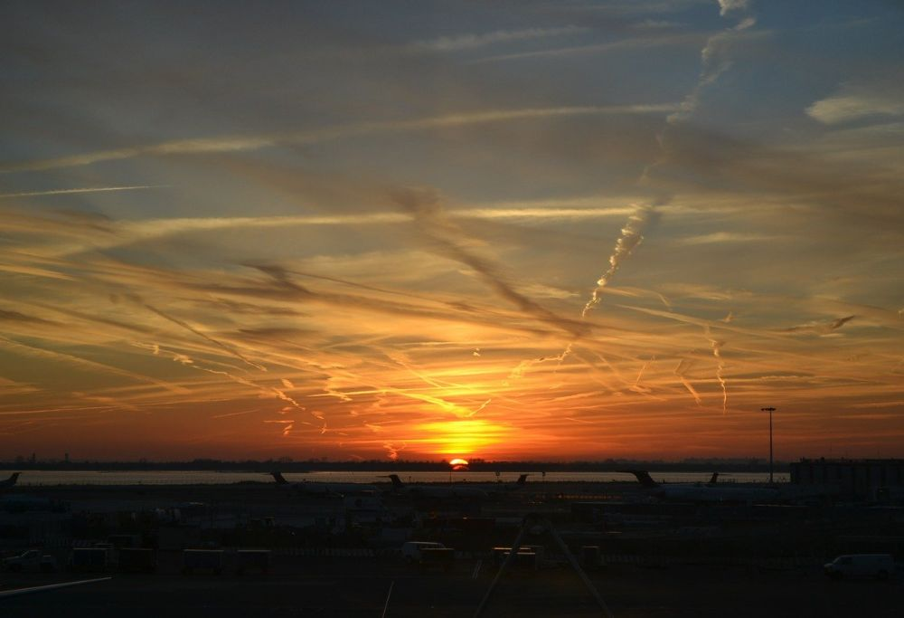 Sunset surrounded by geoengineering clouds